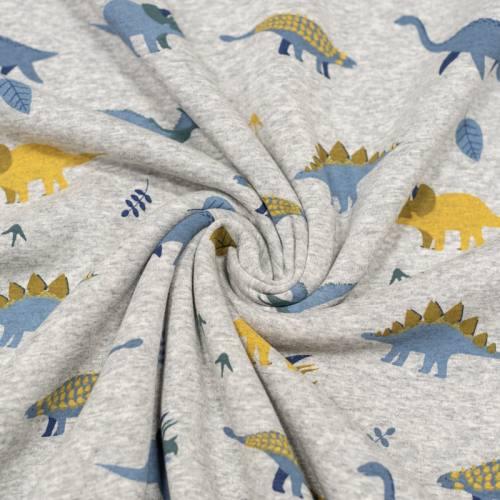 Tissu molleton gris chiné imprimé dinosaure réversible