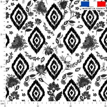 Tissu caban twill écru imprimé ethnique à petits fleurs noires