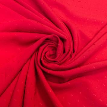 Tissu viscose plumetis rouge