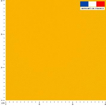 Tissu imperméable jaune uni