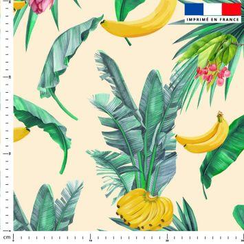 Banane et feuille de palmier - Fond jaune pastel