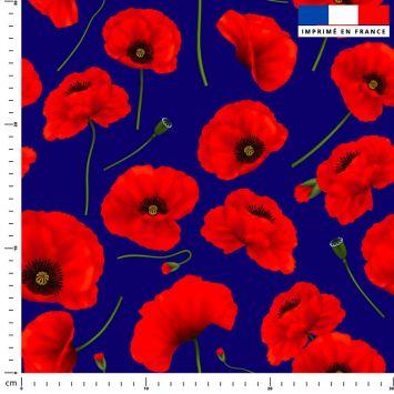 Tissu imperméable bleu motif coquelicot