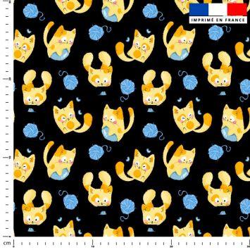 Chaton jaune pelote bleue - Fond noir