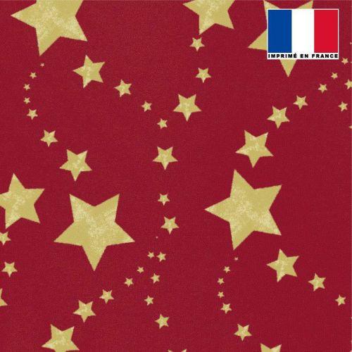 Tissu burlington rouge grenat imprimé étoiles dorées