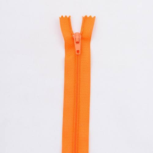 Fermeture 12 cm polyester non séparable orange Col 120