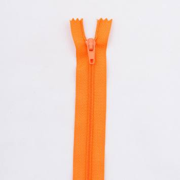 Fermeture 10 cm polyester non séparable orange Col 120