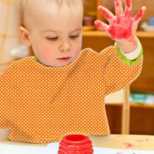 Toile polyester orange petit pois blanc